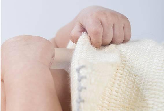 Detalle de la manta para bebé D-leite