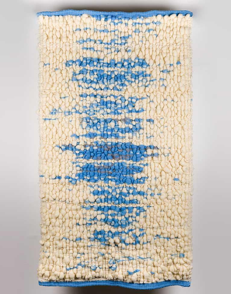 Tapiz de alta suavidad y calidez, de fabricación artesanal, realizado en lana merina y lino